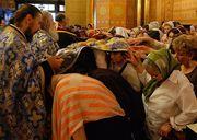 Atingerea de hainele preotesti